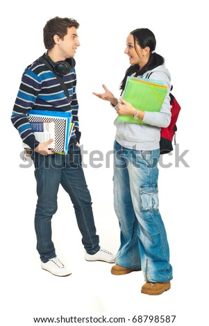 Full length of students couple having conversation isolated on white background - stock photo