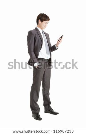 full length of Successful businessman holding smart phone isolated on white - stock photo