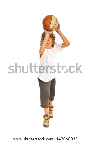 Full length of teen boy throwing basketball isolated on white background - stock photo
