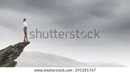 Full length of thoughtful business woman looking away - stock photo