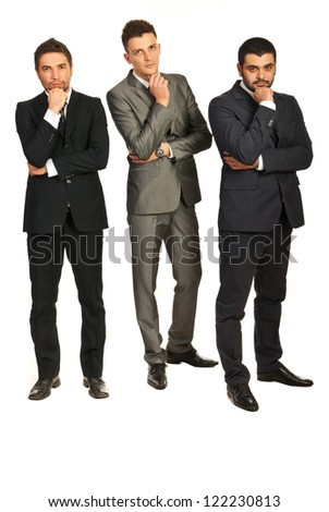 Full length of three business men with problems isolated on white background - stock photo