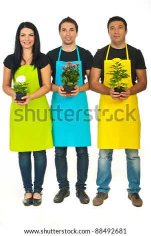 Full length of three florists team holding flowers in pots isolated on white background - stock photo
