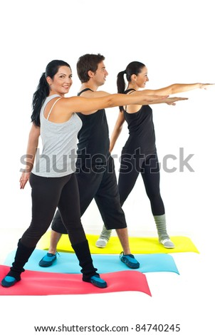 Full length of three people doing fitness over white background - stock photo