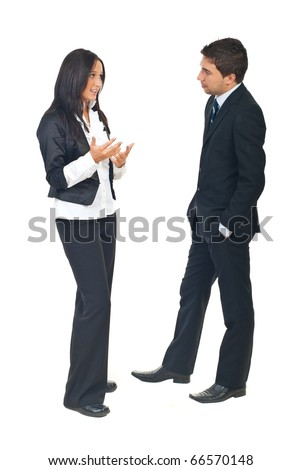 Full length of two business people having a conversation and woman explaining something to man isolatedon white background - stock photo