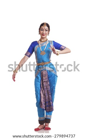 Full length of Woman performing traditional Bharat Natyam dance on white background - stock photo