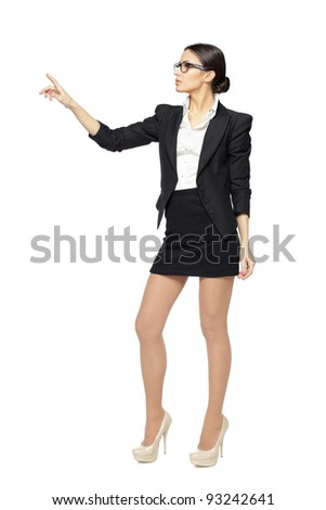 Full length of young business woman pointing at white, isolated on white background - stock photo