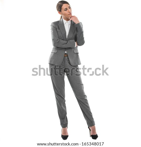 Full length of young business woman thinking, isolated on white background - stock photo