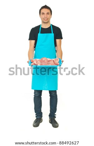 Full length of young butcher holding raw meat isolated on white background - stock photo