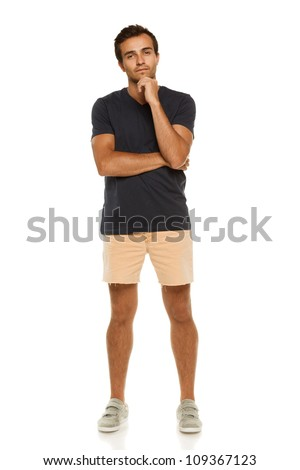 Full length of young pensive male standing over white background, front view. - stock photo