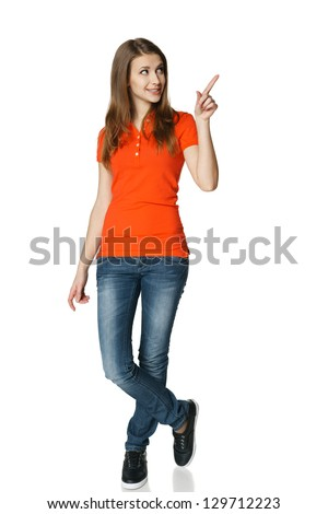Full length of young woman pointing to the side and looking there, isolated on white - stock photo