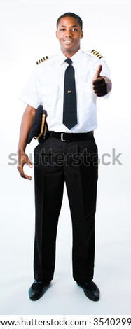 Full length photo of a young pilot - stock photo