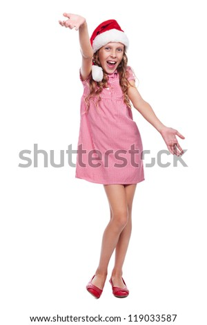 full length photo of excited pretty girl in santa claus hat. isolated on white background - stock photo