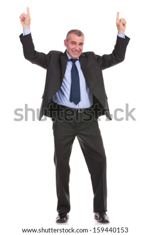 full length picture of a business man pointing upward with both hands while smiling for the camera. on a white background - stock photo