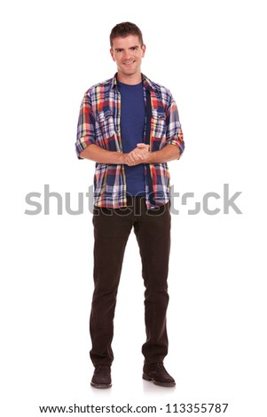 Full length picture of a casual young man standing with his palms together, being thankful - stock photo