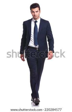 Full length picture of a elegant business man walking on white background, looking at the camera - stock photo