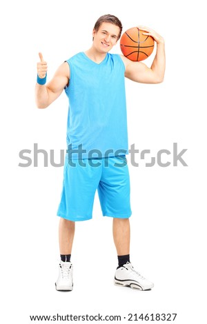 Full length portrait of a basketball player giving a thumb up isolated on white background - stock photo