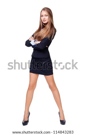 Full length portrait of a beautiful business woman standing with hands folded against isolated on white background - stock photo