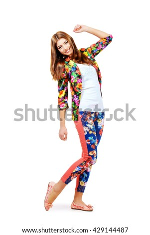 Full length portrait of a beautiful cheerful woman in summer clothes smiling at the camera. Fashion shot. - stock photo