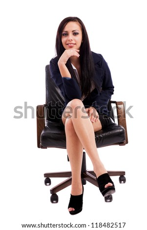 Full length portrait of a beautiful hispanic businesswoman thinking while sitting on an armchair isolated on white background - stock photo