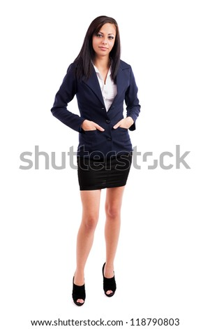 Full length portrait of a beautiful latin businesswoman standing with hands in her pockets isolated on white background - stock photo