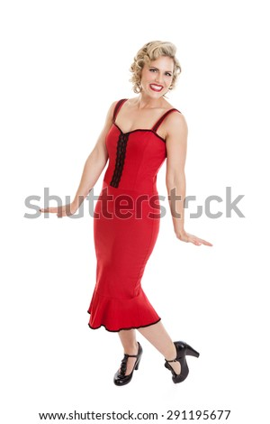 Full length portrait of a beautiful mid 30s blond woman dressed in retro vintage pin up style clothing, hair and makeup isolated on a white background - stock photo