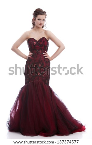 Full length portrait of a beautiful teen ready for prom.  Isolated on white. - stock photo