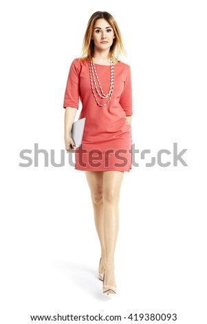 Full length portrait of a beautiful woman walking and looking at you.  - stock photo