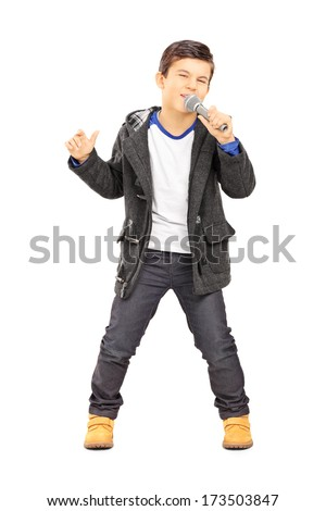 Full length portrait of a boy singing on microphone isolated on white background - stock photo