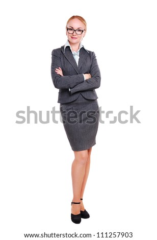 Full length portrait of a business woman isolated on white pointing with her finger - stock photo