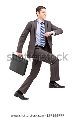 Full length portrait of a businessman climbing a virtual staircase isolated on white background - stock photo