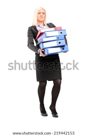 Full length portrait of a businesswoman carrying a pile of folders isolated on white background - stock photo