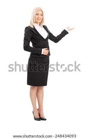 Full length portrait of a businesswoman gesturing with her hand isolated on white background - stock photo
