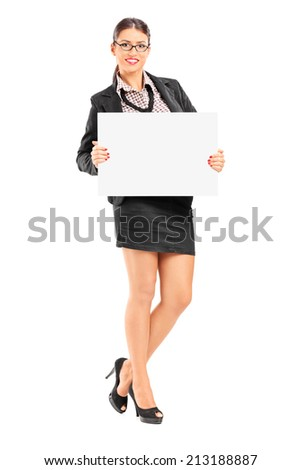 Full length portrait of a businesswoman holding a blank signboard isolated on white background - stock photo