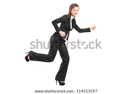 Full length portrait of a businesswoman running isolated on white background - stock photo