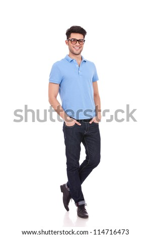 Full length portrait of a casual young man with hands in his pockets on white background - stock photo