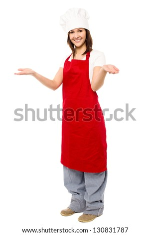 Full length portrait of a charming young female chef isolated on white. - stock photo