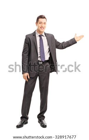 Full length portrait of a cheerful businessman gesturing with his hand and looking at the camera isolated on white background - stock photo