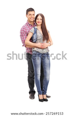 Full length portrait of a cheerful young couple posing isolated on white background - stock photo