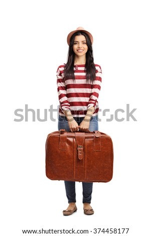 Full length portrait of a cheerful young woman holding a brown briefcase isolated on white background - stock photo