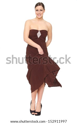 Full length portrait of a cheerful young woman in elegant dress isolated on white background - stock photo