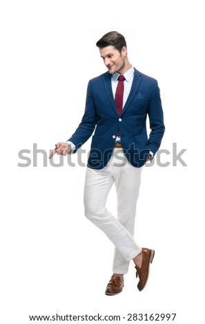 Full length portrait of a confident businessman pointing finger down isolated on a white background - stock photo