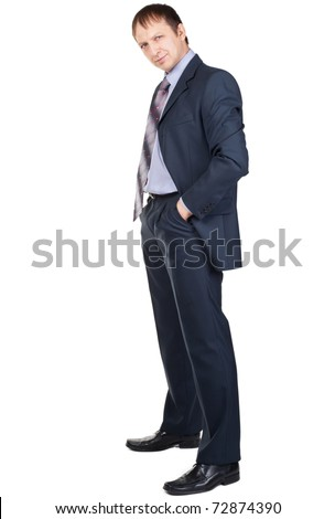 Full length portrait of a confident businessman with hands in pockets, over white background - stock photo