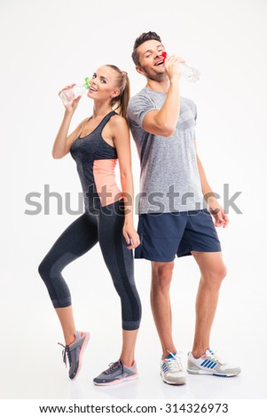 Full length portrait of a couple drinking water isolated on a white background - stock photo