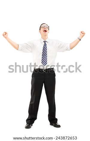 Full length portrait of a delighted young businessman looking up isolated on white background - stock photo