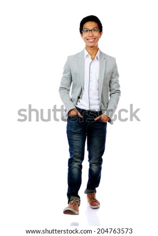 Full length portrait of a fashion man walking forward - stock photo