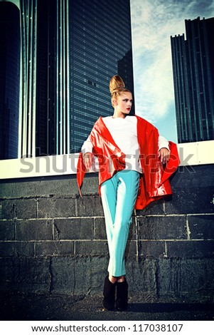 Full length portrait of a fashion model posing over big city background. - stock photo