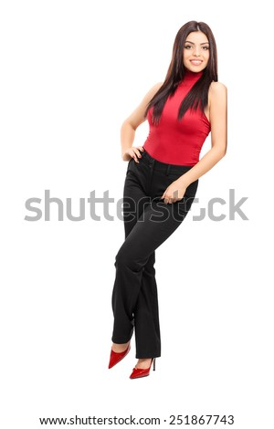 Full length portrait of a fashionable girl leaning against a wall isolated on white background - stock photo