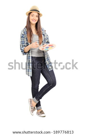 Full length portrait of a female painter leaning against a wall isolated on white background - stock photo