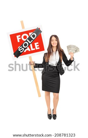 Full length portrait of a female realtor holding a sold sign an money isolated on white background - stock photo