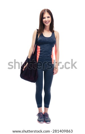 Full length portrait of a fitness woman standing with bag isolated on a white background. Looking at camera - stock photo